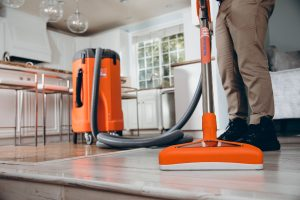 water damage restoration professional extracting water in residence