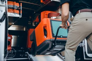 water damage restoration equipment loaded into van